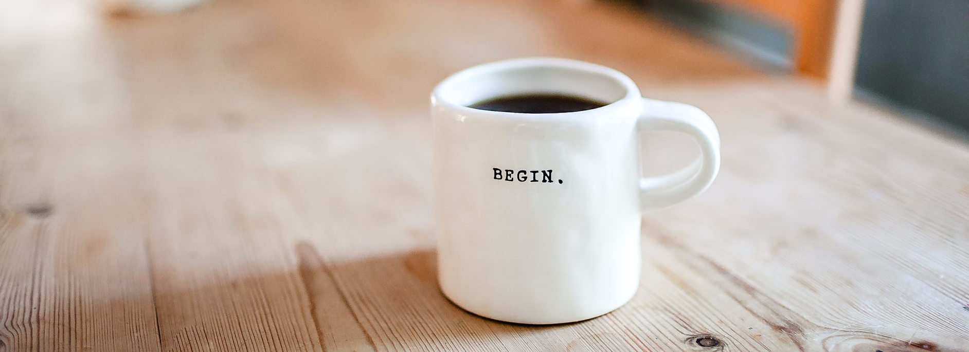 Mug with 'Begin' on front